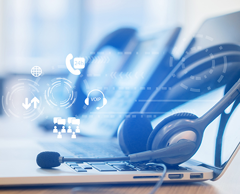 Affiliated Blog close up soft focus on headset with telephone devices at office desk for customer service support